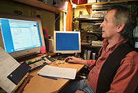 Elliott Bristow at the computer editing the his Road Trips films