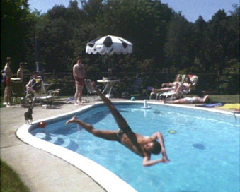 Mid-air dive into pool